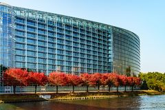 European Parliament In Strasbourg, Autumnal View With Red Trees Royalty Free Stock Photography