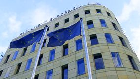 European parliament office in Warsaw and waving EU flags Stock Photo