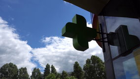 EUROPEAN PHARMACY SIGN: The green cross, often animated, is a symbol found in many countries in Europe.  stock footage