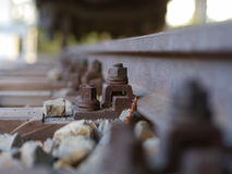European rail construction with a rusty screw and nut Royalty Free Stock Image