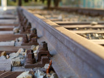 European rail construction with a rusty screw and nut top view. European rail construction with a rusty screw and a nut in a road bed track bed top view Royalty Free Stock Image