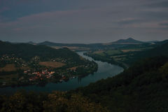 European river Elbe in Cirkvice village when viewed from Mlynaruv kamen lookout in czech central mountains tourist area at sommer. Night Stock Photo