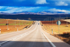 European road among fields and hills Royalty Free Stock Photos