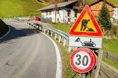 European Roadworks Sign on a Winding Mountain Road Stock Image