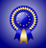 European rosette. And ribbon isolated on blue background Stock Photography