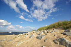 European sandy beach scene. The European summer beach scene. Blue Sky with clouds royalty free stock image