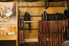 European sausages and fish of traditional food of Germany for sale. Travelers people in shop at Black Forest or Schwarzwald on September 8, 2017 in Stuttgart royalty free stock photography