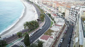 European sea town view with beautiful beach on breathtaking cote d'azur. Along the promenade walk tourist and people who live in france. By seaside riding stock video