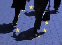 European shoppers. European flag overlaid over silhouetted pedestrians Royalty Free Stock Photos