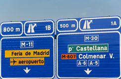 European spanish information road highway signpost in blue tone Royalty Free Stock Photos