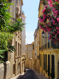 European street. A picturesque narrow street in Montpellier, France Royalty Free Stock Images