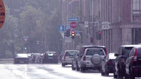 European street autumn rain Riga stock video