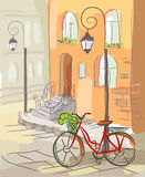 European street with a bicycle and lanterns Royalty Free Stock Photography