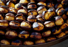 European street food – big and sweet baked chestnuts Stock Photography