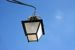 European street lamp over a blue sky. Old and classic european street lamp over a blue sky Royalty Free Stock Images
