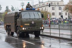 Soldiers of Czech Army are riding decontamination vehicle on military parade. European street, Prague-October 28, 2018: Soldiers of Czech Army are riding stock image