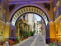 European street. View the town of Cassis through the archway of the General staff Stock Photography
