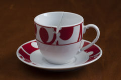 European style broken coffee cup put together Stock Photo