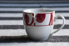 European style broken coffee cup put together. European style white and red broken coffee cup put together Royalty Free Stock Photos