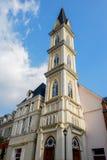 European style clocktower in sunny sky Stock Photo
