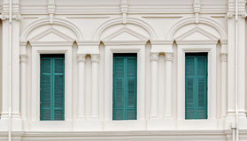 European Style Window with green shutters. In colonial architecture style building Stock Images