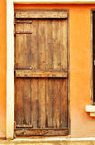 European style wood door on concrete wall Stock Photos