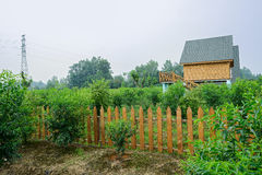 European-style wooden cabins in fenced orchard Stock Photography