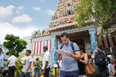 European tourist on background indian temple, Singapore Royalty Free Stock Images