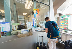 European tourist buys ticket to Suvarnabhumi airport in Bangkok Stock Photos