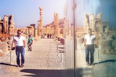 European tourist visiting the old ruins of the ancient Persepolis. Ancient Persia. Iran.  Royalty Free Stock Images