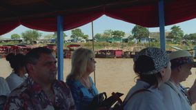 European tourists on board of sailing boat during journey to floating village and lake Tonle Sap. European tourists on board of sailing boat during excursion stock video