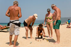 European tourists are playing the game boules Stock Photos