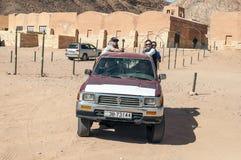 European tourists on safari in the desert Stock Image