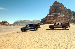 European tourists on safari in the desert Royalty Free Stock Photo