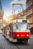 European tram close up. Czech Prague vintage tram in city with Czech castle in background. Travel to Europe stock photos