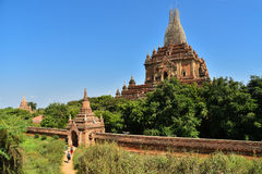European travellers sitting on paveway along pagodas while travel in Bagan ancient city, Mandalay, Myanmar, Asia royalty free stock image