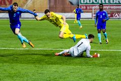 European Under-21 Chamionship match Ukraine - Netherlands. Kyiv, Ukraine - October 10, 2017: Justin Bijlow in action against Oleksii Gutsuliak. European Under Royalty Free Stock Photography