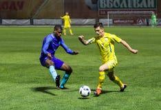 European Under-21 Chamionship match Ukraine - Netherlands. Kyiv, Ukraine - October 10, 2017: Maksym Lunov in action against Denzel Dumfries. European Under-21 Royalty Free Stock Photo
