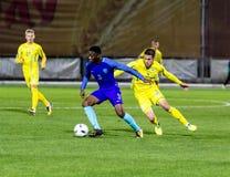 European Under-21 Chamionship match Ukraine - Netherlands. Kyiv, Ukraine - October 10, 2017: Timothy Fosu-Mensah in action against Artem Besedin. European Under Royalty Free Stock Images