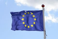 European Union. Euro flag fluttering in strong wind stock image