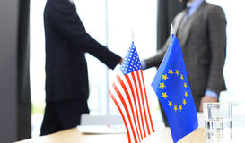 European Union and American leaders shaking hands on a deal agreement. Stock Image