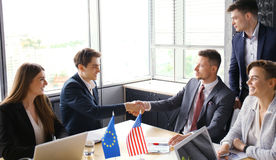 European Union and American leaders shaking hands on a deal agreement. European Union and American leaders shaking hands on a deal agreement Royalty Free Stock Image