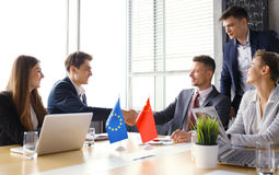 European Union and Chinese leaders shaking hands on a deal agreement. European Union and Chinese leaders shaking hands on a deal agreement Royalty Free Stock Photo