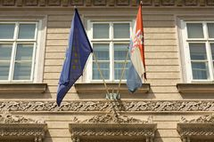 European Union and Croatian flags. On the facade of the building in the Zagreb stock photos
