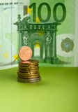 European Union Currency. One hundred Euro bill and coins on the paper Stock Image