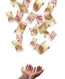 European Union Currency. Falling from above into the hands of somebody. Isolated on white background stock images