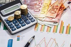 European union currency with calculator, business chart. On desk stock photography