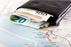 European union currency in a wallet on a map background. Travel concept Stock Photography