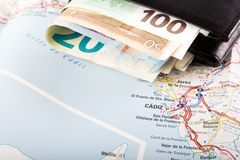 European union currency in a wallet on a map background. Travel concept Stock Image