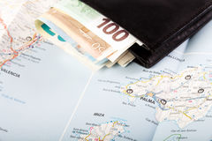 European union currency in a wallet on a map background. Travel concept Royalty Free Stock Images